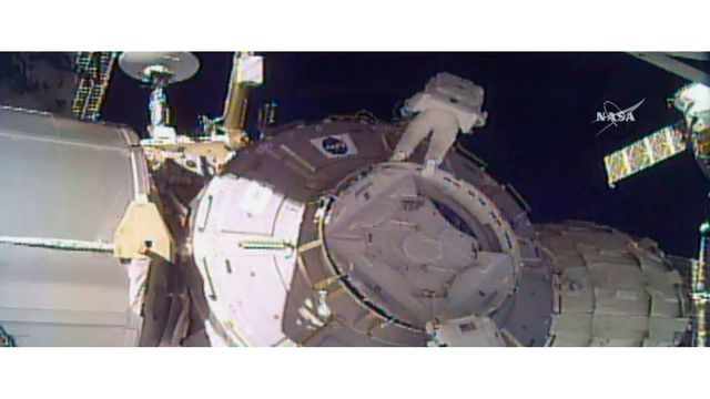 Astronauts lose piece of shielding during record-setting spacewalk
